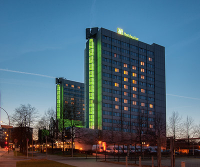 Holiday Inn Hotel Berlin City East exterior at night time