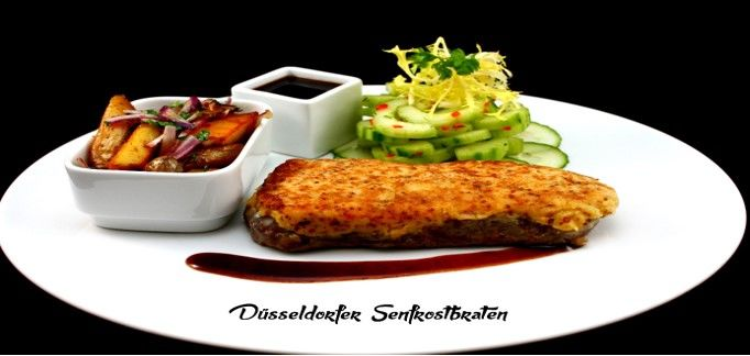 Serving suggestion: Düsseldorf mustard roast with roast potatoes and cucumber salad | © Crowne Plaza Düsseldorf - Neuss